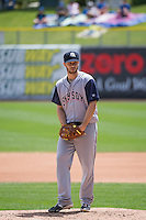 Tyler Thornburg (18) of the Colorado Springs Sky Sox starts his windup against the Salt Lake Bees in Pacific Coast League action at Smith's Ballpark on May 24, 2015 in Salt Lake City, Utah.  (Stephen Smith/Four Seam Images)
