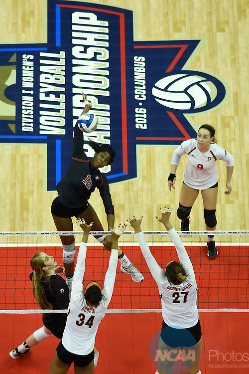 COLUMBUS, OH - DECEMBER 17:  Inky Ajanaku (12) of Stanford University hits a kills against the University of Texas during the Division I Women's Volleyball Championship held at Nationwide Arena on December 17, 2016 in Columbus, Ohio.  Stanford beat Texas 3-1 to win the national title. (Photo by Jamie Schwaberow/NCAA Photos via Getty Images)
