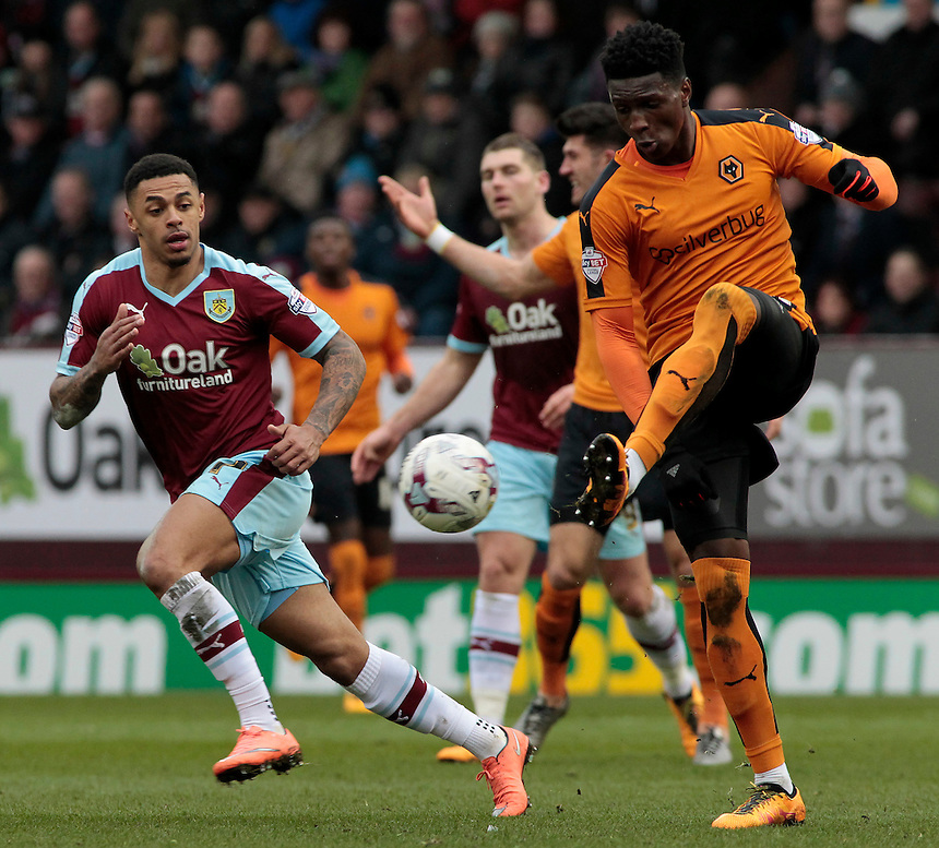 Wolverhampton Wanderers' Kortney Hause is pressured by Burnley's Andre Gray<br /> <br /> Photographer David Shipman/CameraSport<br /> <br /> Football - The Football League Sky Bet Championship - Burnley v Wolverhampton Wanderers - Saturday 19th March 2016 - Turf Moor - Burnley<br /> <br /> &copy; CameraSport - 43 Linden Ave. Countesthorpe. Leicester. England. LE8 5PG - Tel: +44 (0) 116 277 4147 - admin@camerasport.com - www.camerasport.com