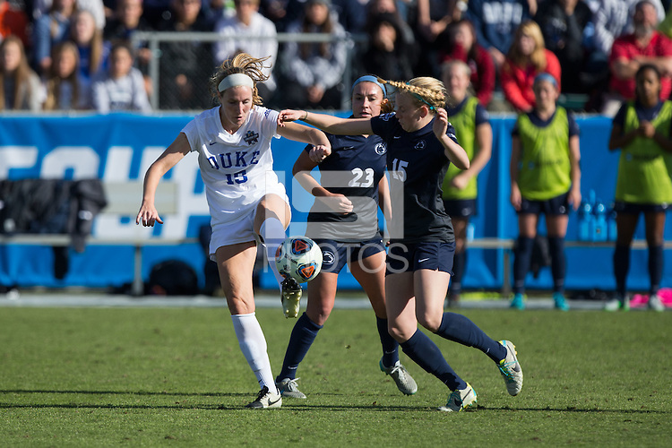 Cary, North Carolina - Sunday December 6, 2015: Kara Wilson (15) of the Duke Blue Devils kicks the ball away from  Haleigh Echard (15) and Nickolette Driesse (23) of the Penn State Nittany Lions during second half action at the 2015 NCAA Women's College Cup at WakeMed Soccer Park.  The Nittany Lions defeated the Blue Devils 1-0.