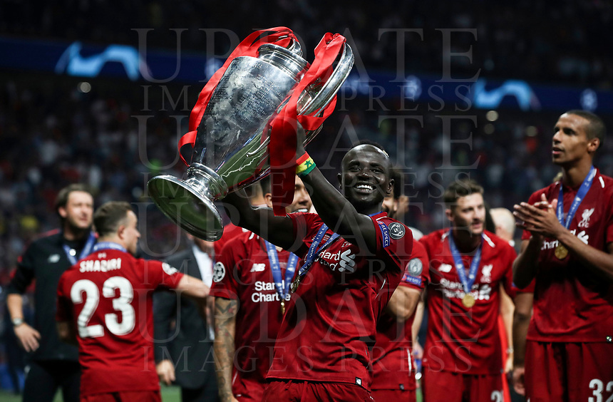 Liverpopol's Sadio Mane', center, holds the trophy at the end of the UEFA Champions League final football match between Tottenham Hotspur and Liverpool at Madrid's Wanda Metropolitano Stadium, Spain, June 1, 2019. Liverpool won 2-0.<br /> UPDATE IMAGES PRESS/Isabella Bonotto