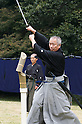 November 3, 2011, Tokyo, Japan - A swordsman cuts a rice mat with his katana at a martial arts demonstration for Japan's National Culture Day at Meiji shrine in Tokyo. (Photo by Bruce Meyer-Kenny/AFLO) [3692]