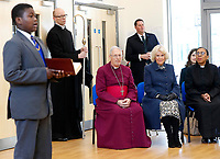 06 February 2019 - Camilla Duchess of Cornwall and Christopher Chessun, Bishop of Southwark watch school children perform during a visit to St John's Angell Town Church of England Primary School  in London. Photo Credit: ALPR/AdMedia