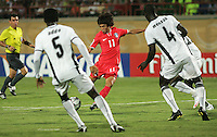South Korea's Jung Jin Seo (11) attempts to get the ball past Ghana's defense during the FIFA Under 20 World Cup Quarter-final match between Ghana and South Korea at the Mubarak Stadium  in Suez, Egypt, on October 09, 2009.