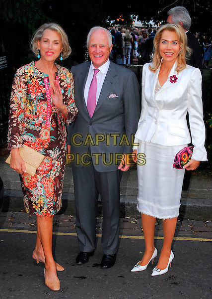 LUCE CHURCHILL, WINSTON CHURCHILL & GUEST.Sir David Frost Summer Party, Carlyle Square, London, UK..July 5th, 2006.Ref: CAN.full length grey gray suit floral print white skirt jacket.www.capitalpictures.com.sales@capitalpictures.com.©Capital Pictures