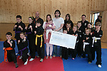 Kempo Karate Kids Present Cheque to Baby Gretta