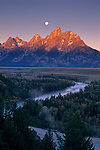 Moonset at dawn over the Teton Range and Snake River, Grand Teton Nat'l. Pk., WYOMING
