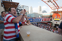 Kansas City, MO - Monday, June 16, 2014:  USA soccer fan Jough Donakowski  (left) of Kansas City cheers while watching the USA vs. Ghana first round World Cup match at a public viewing in the Power and Light District of Kansas City, Missouri.