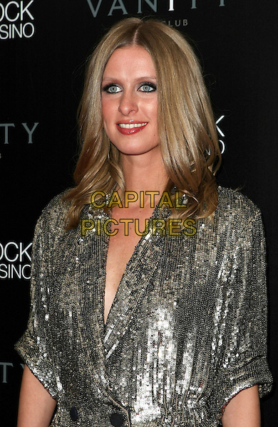NICKY HILTON.hosts Birthday for David Katzenberg at Vanity Nightclub inside the Hard Rock Hotel and Casino, 20th March 2010..half length gold silver sequined sequin coat double breasted shirt dress buttons smiling .CAP/ADM/MJT.©MJT/Admedia/Capital Pictures
