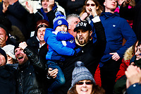 1st February 2020; King Power Stadium, Leicester, Midlands, England; English Premier League Football, Leicester City versus Chelsea; A young Chelsea fan celebrates his team's second goal with his father