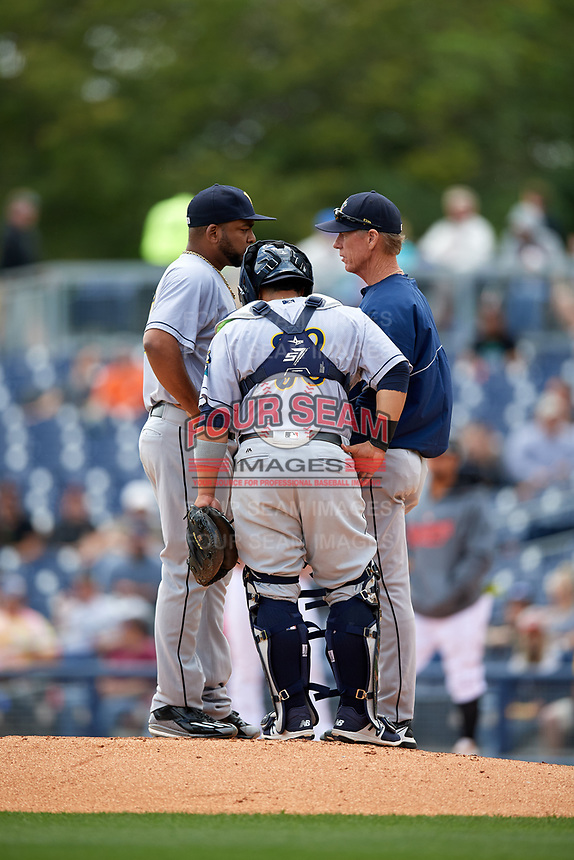 New Orleans Baby Cakes pitching coach Scott Budner (35) talks with his players on the mound during a game against the Nashville Sounds on May 1, 2017 at First Tennessee Park in Nashville, Tennessee.  Nashville defeated New Orleans 6-4.  (Mike Janes/Four Seam Images)