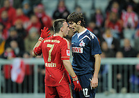 FUSSBALL   1. BUNDESLIGA  SAISON 2011/2012   17. Spieltag   16.12.2011 FC Bayern Muenchen - 1. FC Koeln        Kopf an Kopf; Franck Ribery (li, FC Bayern Muenchen) gegen Henrique Sereno (1. FC Koeln)