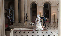 BNPS.co.uk (01202 558833)<br /> Pic: PhilYeomans/BNPS<br /> <br /> Paper artist Denise Watson puts the finishing touches to the 9th Dukes wedding.<br /> <br /> Paper View - The 'Wedding that saved Blenheim Palace' finally appears in Oxfordshire.<br /> <br /> The New York wedding of the 9th Duke of Marlborough to the fantastically wealthy American railroad heiress Consuelo Vanderbilt, has been recreated in paper at Blenheim Palace.<br /> <br /> Charles Spencer-Churchill had inherited his near-bankrupt dukedom in 1892, and was forced to find a quick and drastic solution to the financial problems of his family. <br /> <br /> Prevented by the social dictates of Victorian high society from earning money, he was left with one solution; to marry it.<br /> <br /> Although an unhappy marriage , it did manage to save the Palace where  Winston Churchill had been born in 1874.