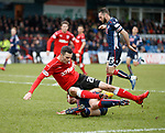 Jamie Murphy tackled by Marcus Fraser in the box