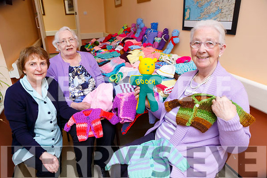 Sheila McGuire, Mary O'Connor and Bernie Leahy with some of the cardigans and teddies created by the people of Castleisland Daycare centre on Wednesday