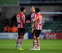 Lincoln City players, from left, Matt Green, Matt Rhead and Bruno Andrade speak during a break in play<br /> <br /> Photographer Chris Vaughan/CameraSport<br /> <br /> The Emirates FA Cup Second Round - Lincoln City v Carlisle United - Saturday 1st December 2018 - Sincil Bank - Lincoln<br />  <br /> World Copyright © 2018 CameraSport. All rights reserved. 43 Linden Ave. Countesthorpe. Leicester. England. LE8 5PG - Tel: +44 (0) 116 277 4147 - admin@camerasport.com - www.camerasport.com