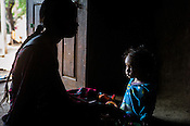 18 month old Prahlad RAMESH, a recovering malnourished boy is seen with his 21 year old mother, Rekha RAMESH in their house in Dhawati VIllage of Khaknar block of Burhanpur district in Madhya Pradesh, India.  Photo: Sanjit Das/Panos for ACF