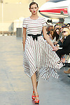Lena walks runway in a Douglas Hannant Resort 2012 outfit, on the USS Intrepid, June 7, 2011.