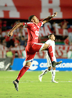 CALI - COLOMBIA-14-09-2015: Ayron del Valle jugador de América de Cali celebra un gol anotado a Depor FC durante partido por la fecha 10 de vuelta del Torneo Aguila 2015 jugado en el estadio Pascual Guerrero de la ciudad de Cali./ Ayron del Valle player of America de Cali celebrates a goal scored to Depor FC and during match for the 10th date of second leg of Aguila Tournament 2015 played at Pascual Guerrero stadium in Cali city. Photo: VizzorImage / Juan C Quintero