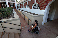 Former UVa student Jasmine Korur uses the long ramp in front of the Rotunda to access the lawn area at the University of Virginia in Charlottesville, Va. Photo/Andrew Shurtleff