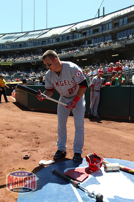 OAKLAND, CA - AUGUST 8:  Mike Trout of the Los Angeles Angels gets ready in the on deck circle before the game against the Oakland Athletics at O.co Coliseum on Wednesday, August 8, 2012 in Oakland, California. Photo by Brad Mangin