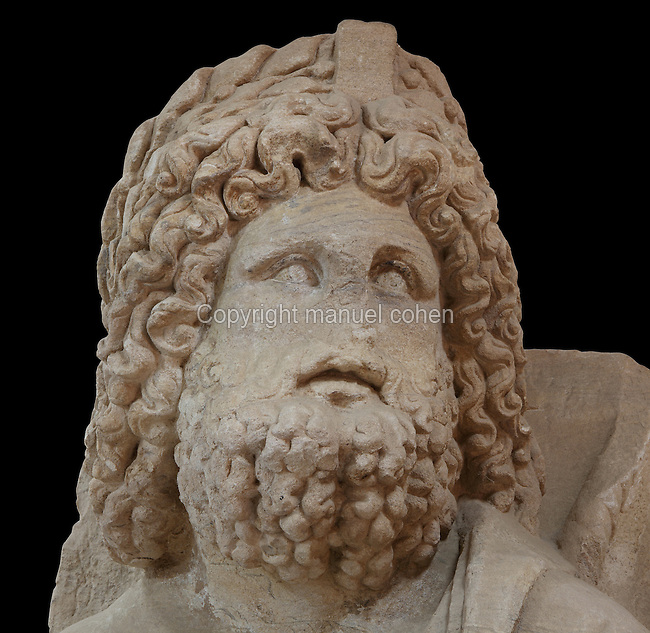 Statue of Serapis found near monumental gate at Petra, Ma'an, Jordan, from Petra Archaeological Museum. Serapis was a Graeco-Egyptian god and only the top part of this statue remains. He is depicted in oriental style with curly hair and beard. Petra was the capital and royal city of the Nabateans, Arabic desert nomads. Picture by Manuel Cohen