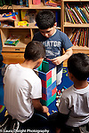 Education preschool 3-4 year olds three boys working together to build structure from magnetic blocks
