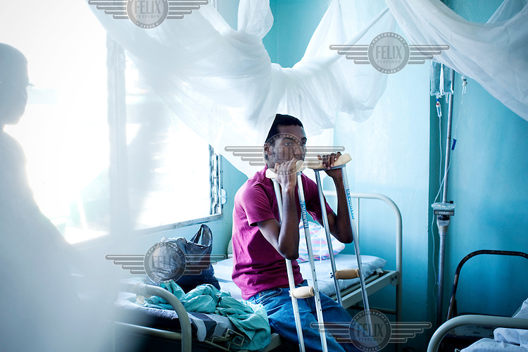 A patient with crutches in Chancerelle hospital, where Medecins Sans Frontieres (MSF) are treating people injured when an earthquake hit the country. A 7.0 magnitude earthquake struck Haiti on 12/01/2010. Early reports indicated that more than 100,000 may have been killed and three million affected.