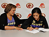 Tori Harris of Half Hollow Hills West High School signs a letter of intent to play NCAA women's basketball at James Madison University as her proud mother, Lisa Harris, watches the signing inside the school on Wednesday, Nov. 9, 2016. Tori is the younger sister of NBA player and fellow Hills West alumnus Tobias Harris.