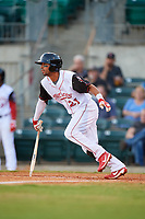 Arkansas Travelers shortstop Joey Wong (21) follows through on a swing during a game against the Midland RockHounds on May 25, 2017 at Dickey-Stephens Park in Little Rock, Arkansas.  Midland defeated Arkansas 8-1.  (Mike Janes/Four Seam Images)