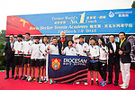 Tennis legend Boris Becker poses for a photograph with the Diocesan Boys' School during the press conference for the opening of Boris Becker Tennis Academy at Mission Hills Resort on 19 March 2016, in Shenzhen, China. Photo by Lucas Schifres / Power Sport Images