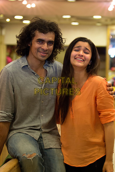 Imtiaz Ali (director), Alia Bhatt <br /> on the set of Highway (2014) <br /> *Filmstill - Editorial Use Only*<br /> CAP/NFS<br /> Image supplied by Capital Pictures