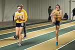 January 25, 2014. Winston Salem, North Carolina.<br /> Kayla Montgomery, right, warms up with teammate Megan Elmore before running in the 1600m at the 2014 David Oliver Classic. <br />  3 and a half years ago, during an examination after sustaining tailbone and head injuries from a fall during a soccer game, Kayla Montgomery, now 18, was diagnosed with multiple sclerosis. Montgomery, then a decent runner, refused to be limited by her diagnosis, and after years of training has become one of the best high school runners in the country.