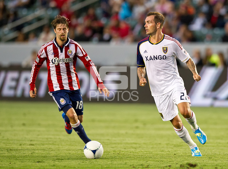 CARSON, CA - June 16, 2012: Chivas USA midfielder Blair Gavin (18) and Real Salt Lake midfielder Jonny Steele (22) during the Chivas USA vs Real Salt Lake match at the Home Depot Center in Carson, California. Final score Real Salt Lake 3, Chivas USA 0.