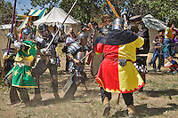 The Renaissance Fair is held each September at the historic museum of El Rancho de Las Golondrinas near Santa Fe and features dancers, kinghts, acrobats and many other performers all celebrating the culture and life style of the Medieval Middle Ages. Knights in home made armor from the Society for Creative Anachronism do battle to win the favor of the King and Queen. A group of knights engage in battle.