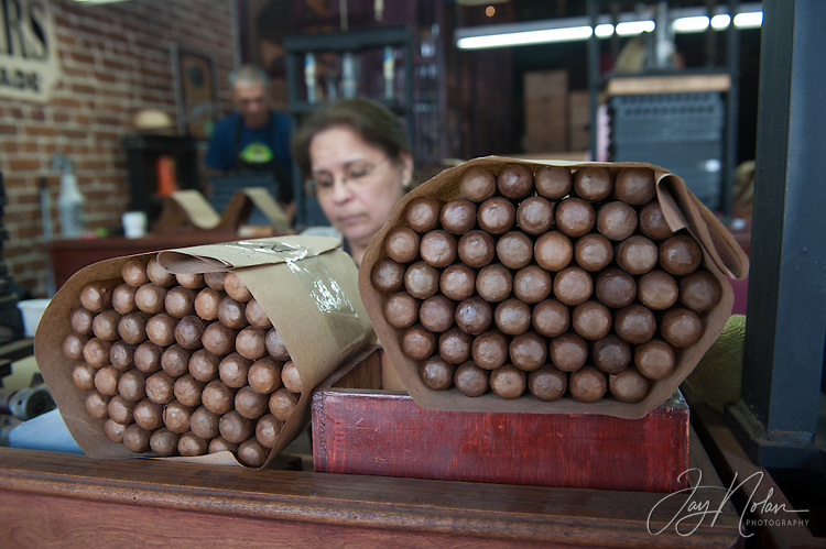 Cigar makers stack completed cigars in a shop along 7th Avenue in Ybor City today, Thursday 6/11/15.<br />Photo/Jay Nolan