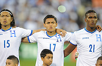 Washington, D.C.- May 29, 2014. Honduras midfielder Andy Najar with teammates midfielder Roger Ezpinoza to the left and defender Brayan Beckelesto the right.  Turkey defeated Honduras 2-0 during an international friendly game at RFK Stadium.