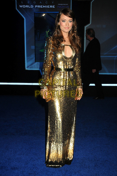 """OLIVIA WILDE .""""TRON: Legacy"""" L.A. Premiere held at the El Capitan Theatre, Hollywood, California, USA, 11th December 2010..full length clutch bag shiny gold cut out sequined sequin dress long sleeve maxi .CAP/ADM/BP.©Byron Purvis/AdMedia/Capital Pictures."""