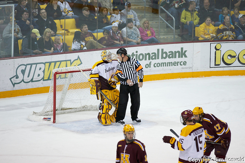 14 Oct 11: Kenny Reiter (Minnesota-Duluth - 35), Derek Sheperd (WCHA Referee - 3) The University of Minnesota-Duluth Bulldogs host the University of Minnesota Golden Gophers in a WCHA matchup at Amsoil Arena in Duluth, MN.