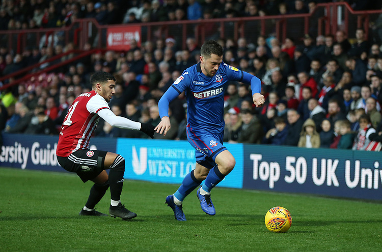 Brentford's Said Benrahma and Bolton Wanderers' Andrew Taylor<br /> <br /> Photographer Rob Newell/CameraSport<br /> <br /> The EFL Sky Bet Championship - Brentford v Bolton Wanderers - Saturday 22nd December 2018 - Griffin Park - Brentford<br /> <br /> World Copyright © 2018 CameraSport. All rights reserved. 43 Linden Ave. Countesthorpe. Leicester. England. LE8 5PG - Tel: +44 (0) 116 277 4147 - admin@camerasport.com - www.camerasport.com
