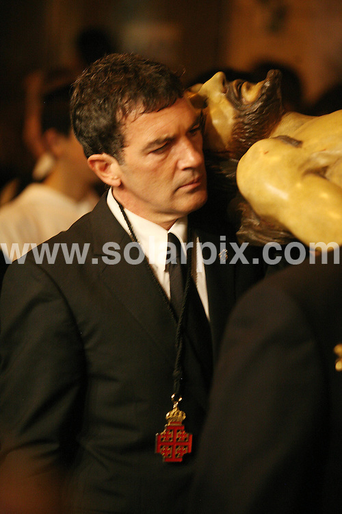 **ALL ROUND PICTURES FROM SOLARPIX.COM**                                             **WORLDWIDE SYNDICATION RIGHTS EXCEPT SPAIN & SOUTH AMERICA - NO SYNDICATION IN SPAIN OR SOUTH AMERICA**                                                                                  Caption:  Hollywood actor Antonio Banderas joined the Semana Santa Easter Parade processions in his home town Malaga last night carrying an effigy of a crucifix with Jesus Crist..Malaga is famous for its Easter processions and Antonio will join in with hi own brotherhood called the Virgen de Lágrimas y Favores.                                                                             This pic: Antonio Banderas                                                                                             JOB REF:13159        MPA       DATE:16.04.2011                                                            **MUST CREDIT SOLARPIX.COM OR DOUBLE FEE WILL BE CHARGED**                                                                      **MUST AGREE FEE BEFORE ONLINE USAGE**                               **CALL US ON: +34 952 811 768 or LOW RATE FROM UK 0844 617 7637**