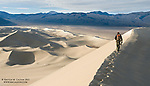 A hiker traverses the edge of Sand Mountain, the tallest dune in California.<br />