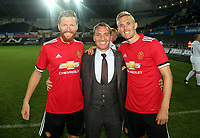 Brendan Rodgers (C) of Swansea Legends with Manchester United players during the Swansea Legends v Manchester United Legends at The Liberty Stadium, Swansea, Wales, UK. Wednesday 09 August 2017