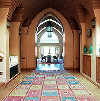 Colourful kilims cover the floor of the entrance hall which has a vaulted ceiling