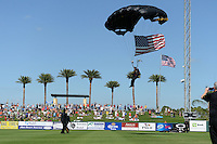 Paratrooper lands with the American flag in center field before a Detroit Tigers spring training game against the St. Louis Cardinals on March 3, 2014 at Joker Marchant Stadium in Lakeland, Florida.  Detroit defeated St. Louis 8-5.  (Mike Janes/Four Seam Images)