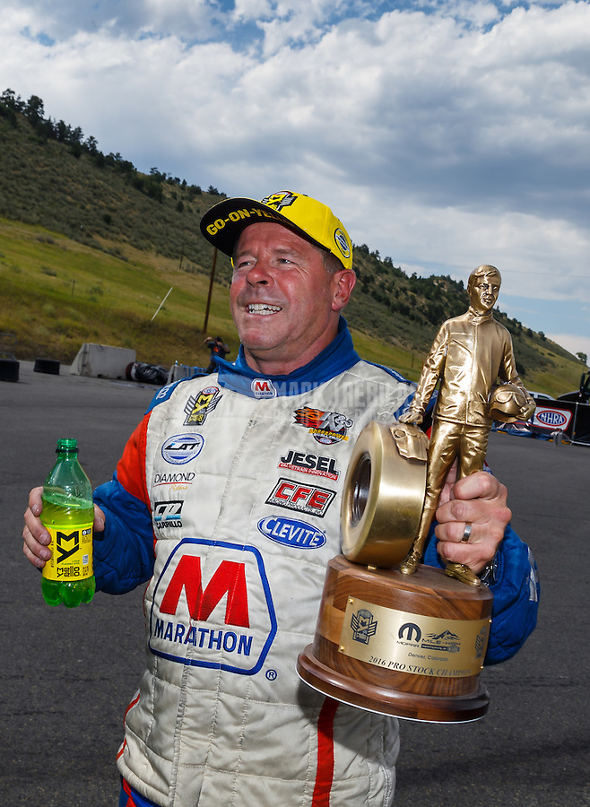 Jul 24, 2016; Morrison, CO, USA; NHRA pro stock driver Allen Johnson celebrates after winning the Mile High Nationals at Bandimere Speedway. Mandatory Credit: Mark J. Rebilas-USA TODAY Sports