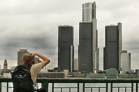 WINDSOR, ON. JULY 12, 2006. - Udo Koehler, a german tourist, takes a picture of the Detroit Skyline from Windsor Dieppe Garden Wednesday July 12 2006. Koehler just landed in Canada and expects to go see Niagara Falls in the following days. (Windsor Star - Francis Vachon)<br />