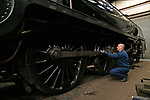 Pictured: Richard Bentley, Operations manager on the Midhants railway cleans a 1920 LSWR S15 class steam train in the railyard in Ropley, Hants ahead of the proposed reopening of the Watercress Line in July. <br /> <br /> Due to the Coronavirus pandemic the railway is currently reliant on the cash reserves it had carefully built in order for future investment into the line.The Watercress Line requires over £800,000 of investment over the next couple of years and is using those savings at present to cover the overhead costs of the heritage line.<br /> <br /> The coronavirus pandemic forced the heritage railway line to close for only the second time in its history, and Midhants railway have set up a page accepting voluntary donations which will go directly towards future investment into the Watercress Line.<br /> <br /> © Jordan Pettitt/Solent News & Photo Agency<br /> UK +44 (0) 2380 458800