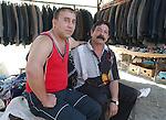 Korca/Korce-Albania - August 03, 2004---Two vendors of jackets on the central market of Korca;  project area of GTZ-Wiram-Albania (German Technical Cooperation, Deutsche Gesellschaft fuer Technische Zusammenarbeit (GTZ) GmbH); business-economy-portrait---Photo: Horst Wagner/eup-images