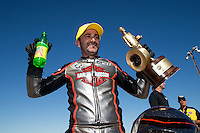 Sept. 22, 2013; Ennis, TX, USA: NHRA pro stock motorcycle rider Eddie Krawiec celebrates after winning the Fall Nationals at the Texas Motorplex. Mandatory Credit: Mark J. Rebilas-